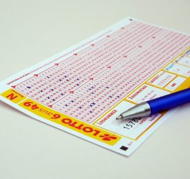 Lottery Ticket and Pen Image